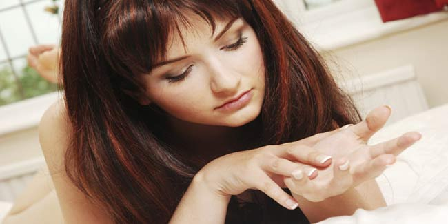 Image result for girl looking to her nails