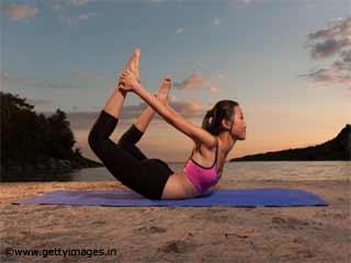 Puran Dhanush Yoga Asana