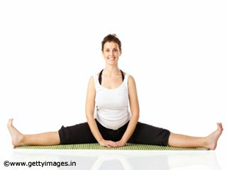 Seated Wide Angled Forward Bend Pose Yoga During Pregnancy