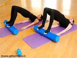 Spine Roll Pilates Reformer Exercise
