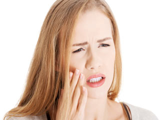 What are the symptoms of Impacted Tooth?