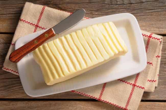 जलने पर मक्खन लगना