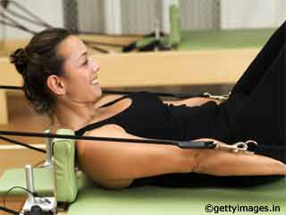Bicep Curls - Pilates Reformer Exercises