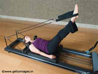 Frog Stretch - Pilates Reformer Exercises