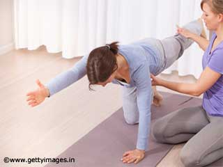 Pilates Opposite Arm Opposite Leg Stretch