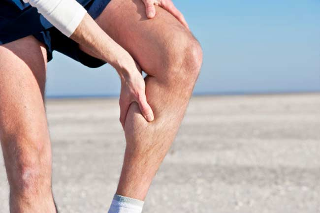 Achilles tendinitis: Pain in the back of your heel and lower calf.