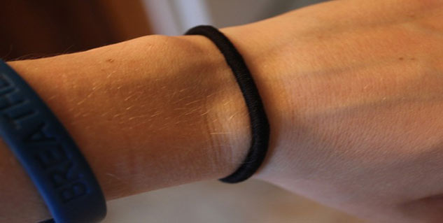 wearing hair band on wrists