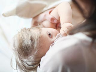 Breastfeeding Prepares Baby's Belly for Solid Food