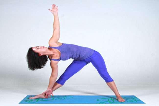 Not bending spine properly in the triangle pose