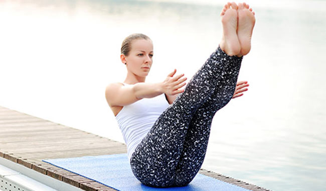 Have a flat tummy in minutes with these yoga poses