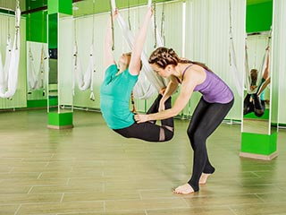 Practice aerial yoga for weight loss and a healthy body