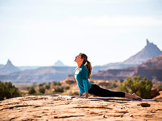 Cure your back ache with proper posture and yoga asanas