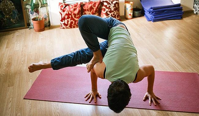 Practice Bikram yoga to cure back pain