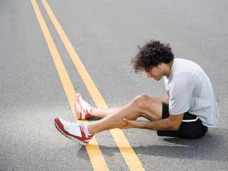 What are the symptoms of Shin Splints?