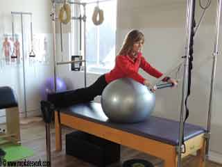 Spine <strong>Stretch</strong> on the Ball Pilates Reformer Exercises