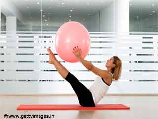 Exercises For Women -Advanced Medicine Ball Crunches