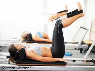 Leg Stretch - Pilates Reformer Exercises