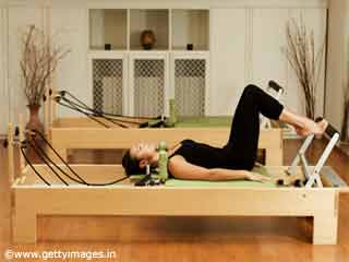 Pelvic Tilts Pilates Reformer Exercise