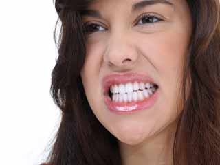 What are the symptoms of Bruxism?