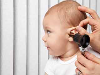 What are the symptoms of Otitis Media in Children?