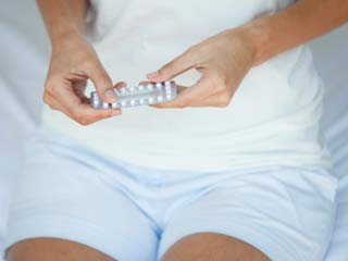 How do birth control pills <strong>work</strong>?