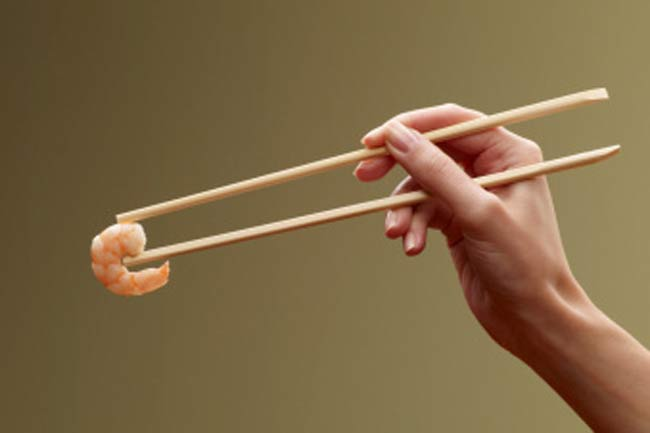 Don't pass food with chopsticks in Japan