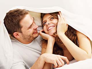 Try this new thing in bed with your partner for a peaceful sleep. No, it's not sex!