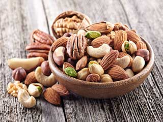 Regular <strong>consumption</strong> of nuts may cut the risk of colon cancer