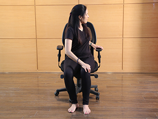 Fitness at work : Easy <strong>yoga</strong> <strong>poses</strong> you can do while standing or sitting